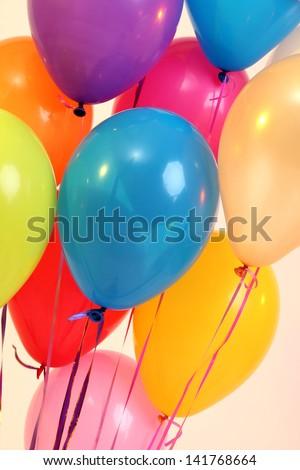 Many bright balloons close-up - stock photo