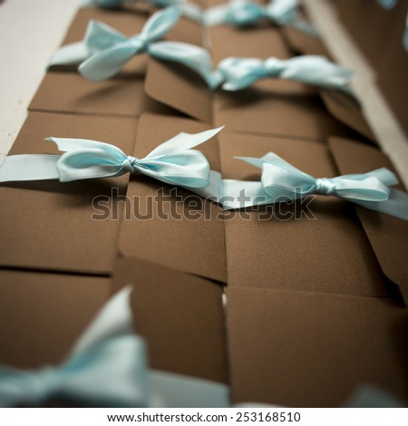 many brown envelope with blue ribbon handmade on  shredded paper for Gifting, Shipping - stock photo
