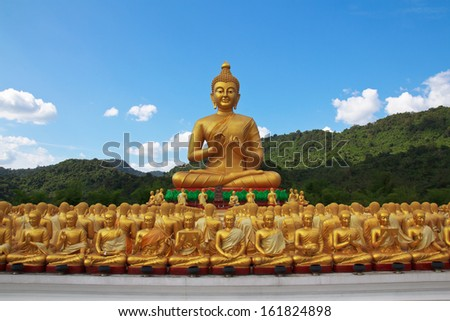 Many buddha statue under blue sky in temple, Nakornnayok , Thailand - stock photo