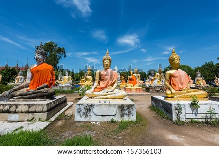 Many Buddha statues against blue sky at Wat Phai Rong Wua , Suphanburi, Thailand