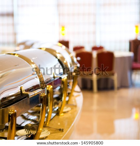 Many buffet heated trays ready for service. - stock photo