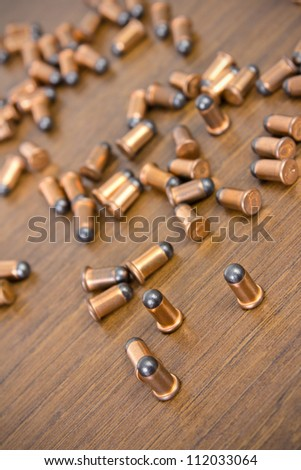 many bullets on wood background