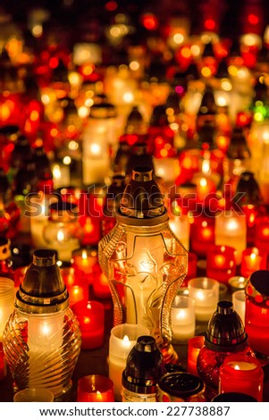 Many burning candles in the cemetery at night on the occasion memory of the deceased.Souls.