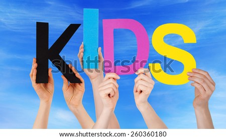 Many Caucasian People And Hands Holding Colorful Letters Or Characters Building The English Word Kids On Blue Sky - stock photo