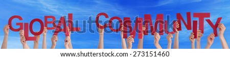 Many Caucasian People And Hands Holding Red Letters Or Characters Building The English Word Global Community On Blue Sky - stock photo