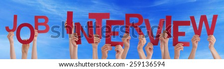 Many Caucasian People And Hands Holding Red Letters Or Characters Building The English Word Job Interview On Blue Sky - stock photo