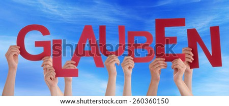 Many Caucasian People And Hands Holding Red Letters Or Characters Building The German Word Glauben Which Means Believe On Blue Sky - stock photo