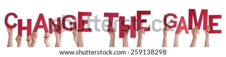 Many Caucasian People And Hands Holding Red Letters Or Characters Building The Isolated English Word Change The Game On White Background - stock photo