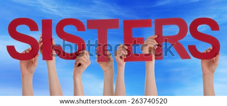 Many Caucasian People And Hands Holding Red Straight Letters Or Characters Building The English Word Sisters On Blue Sky - stock photo