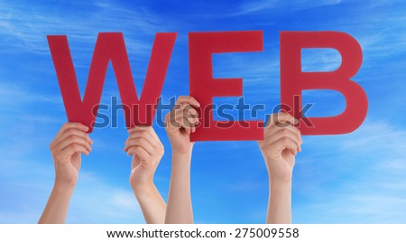 Many Caucasian People And Hands Holding Red Straight Letters Or Characters Building The English Word Web On Blue Sky - stock photo