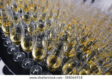 Many champagne glasses in row at wedding reception - stock photo