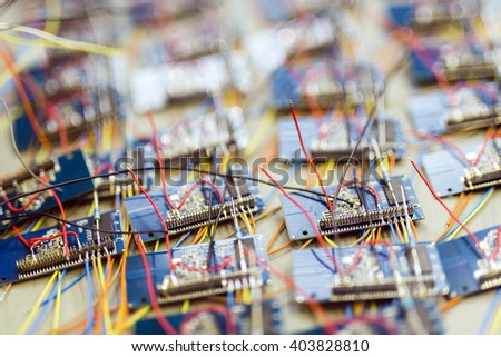 Many chips waiting to be soldered onto a board, representing mass production - stock photo