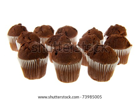 Many chocolate muffins in paper on white background