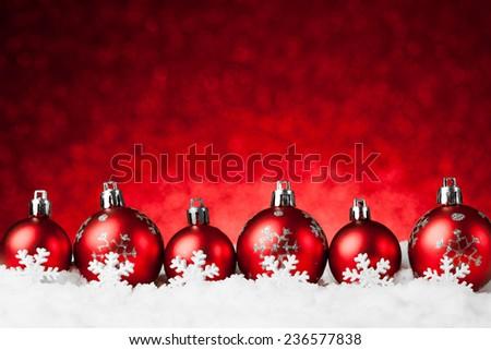 many christmas balls in the snow. studio shot - stock photo