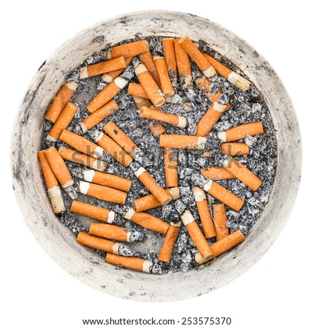 many cigarette ends in plastic ashtray isolated on white background - stock photo