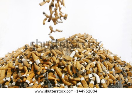 Many cigarette smoked in the crowd, in many countries, smoking is prohibited and encourages a healthy lifestyle and cessation of smoking - stock photo