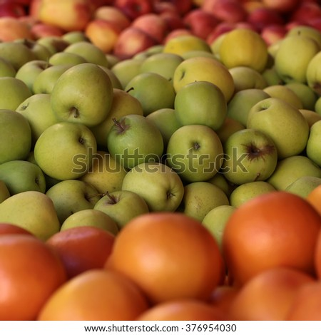 Many clean organic natural fresh tasty ripe grape-fruits green red apples crop fruit full of vitamin for healthy eating diet ball form for sale on blurred background, square picture - stock photo