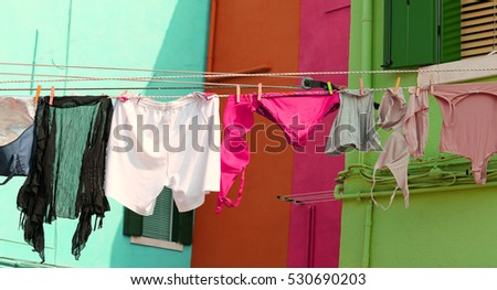 many clothes and underwear lying in the sun to dry