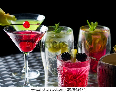 Many cocktails at the nightclub over dark background - stock photo