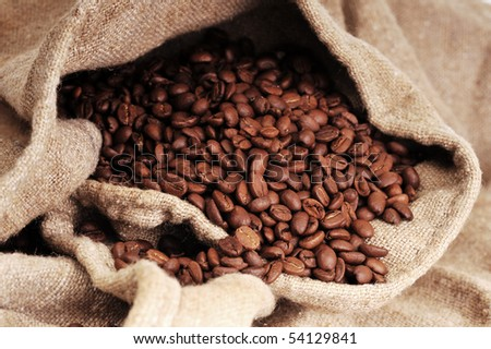 Many coffee grains on rough fabric