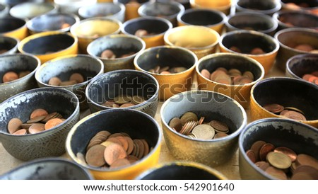 Many coins for make merit