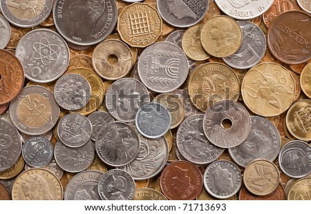 many coins from various countries background - stock photo