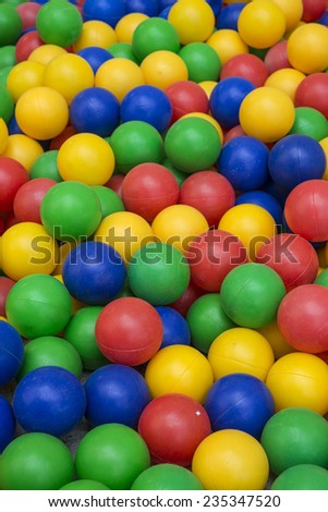 Many color plastic balls from children's small town  - stock photo