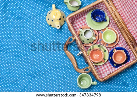many colored ceramic dishes laid out on a blue background