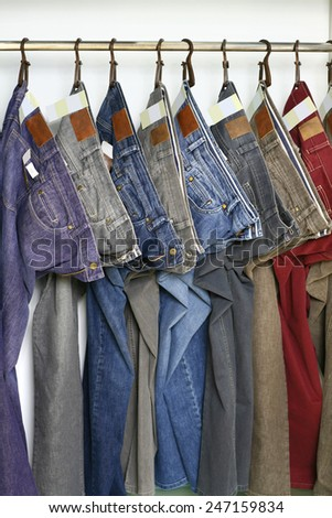 many colored fashion jeans sale in store - stock photo