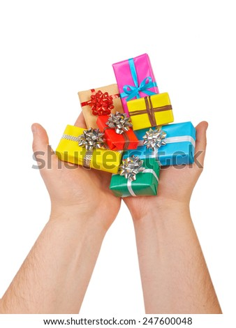 Many colored gift boxes in hands isolated on white background - stock photo