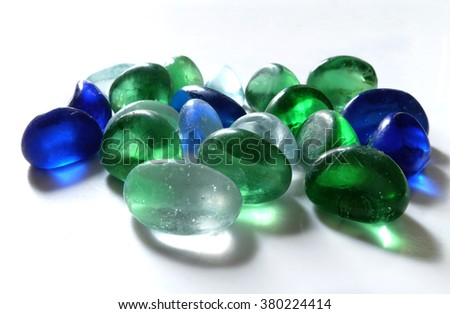 Many colored glass stone on white background