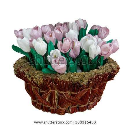 Many colored paper flowers in the basket - stock photo
