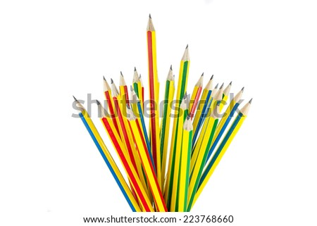Many colored pencils on a white background. - stock photo
