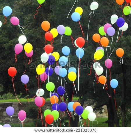 Many colorful baloons flying in the air - stock photo