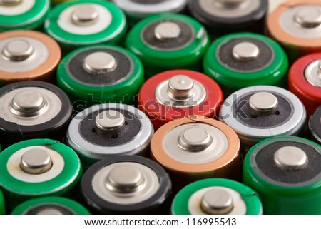 Many colorful batteries in a rows