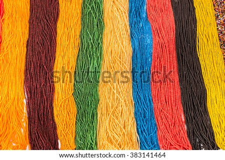 Many colorful beads for necklaces kept side by side - stock photo