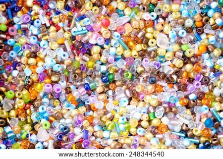 many colorful beads, mixed - stock photo
