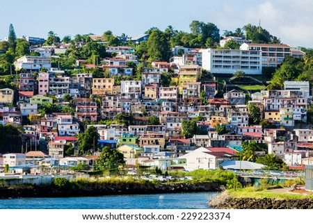 Many colorful buildings on the coast of Martinique - stock photo