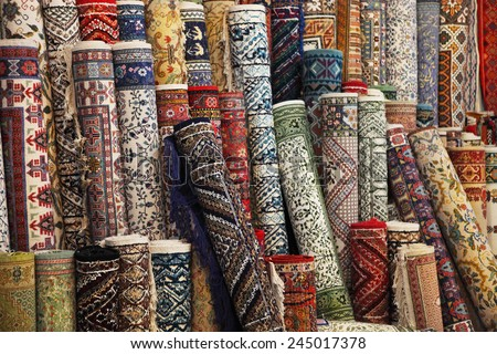 Many colorful carpets in the store. Background - stock photo