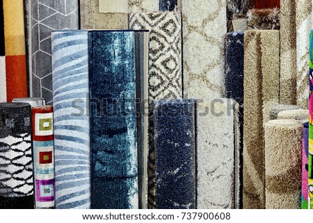 Many colorful carpets in the store. Background. Carpet Rolls Shop Colourful Fabric decoration