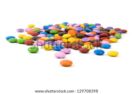 Many colorful chocolate candy on white background - stock photo