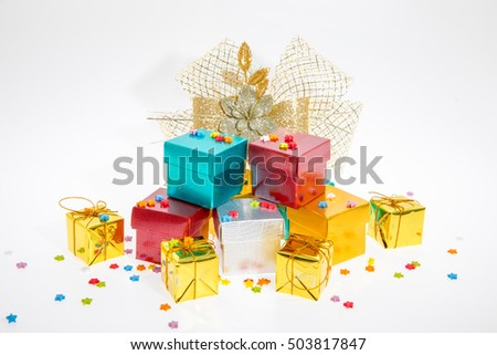 Many colorful gift boxes on white background.