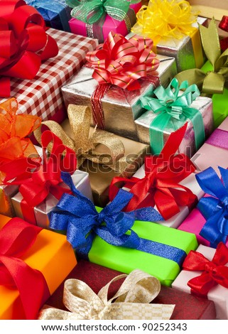 many colorful gift boxes with ribbon bows - stock photo