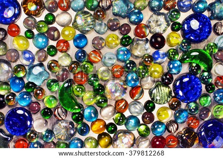 Many colorful glass marbles - stock photo