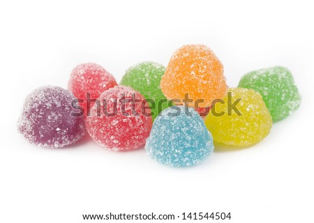 many colorful gummy candies on white background