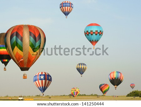 Many colorful hot air balloons rising and falling.