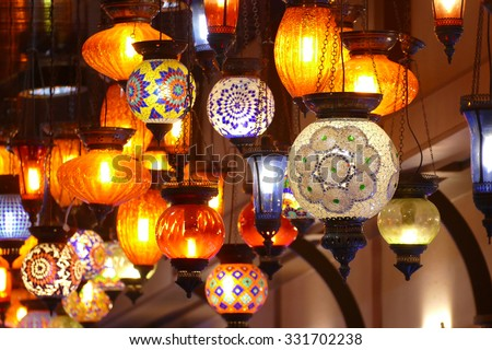 Many colorful lamps on ceiling - stock photo