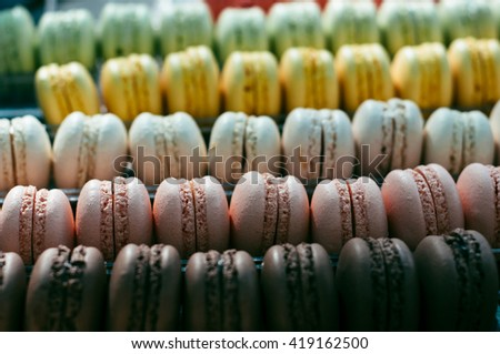 many colorful macaroons assorted background - stock photo