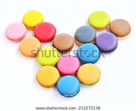 Many colorful macaroons dessert to taste.