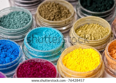 Many colorful, natural, mineral eyeshadows isolated on white